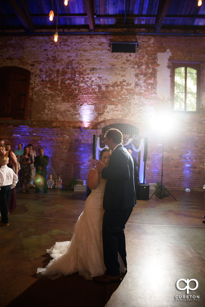 Father of the bride dancing with his daughter at the wedding reception in Greenville at The Old Cigar Warehouse.