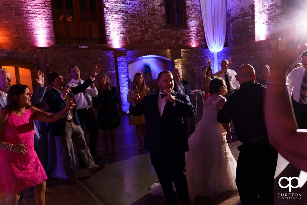 Wedding guests dancing at The Old Cigar Warehouse.