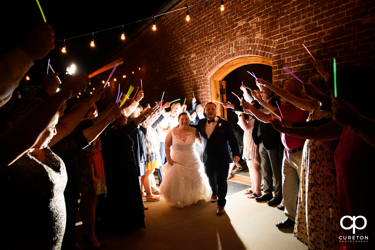 Bride and groom making a grand exit at The Old Cigar Warehouse wedding.
