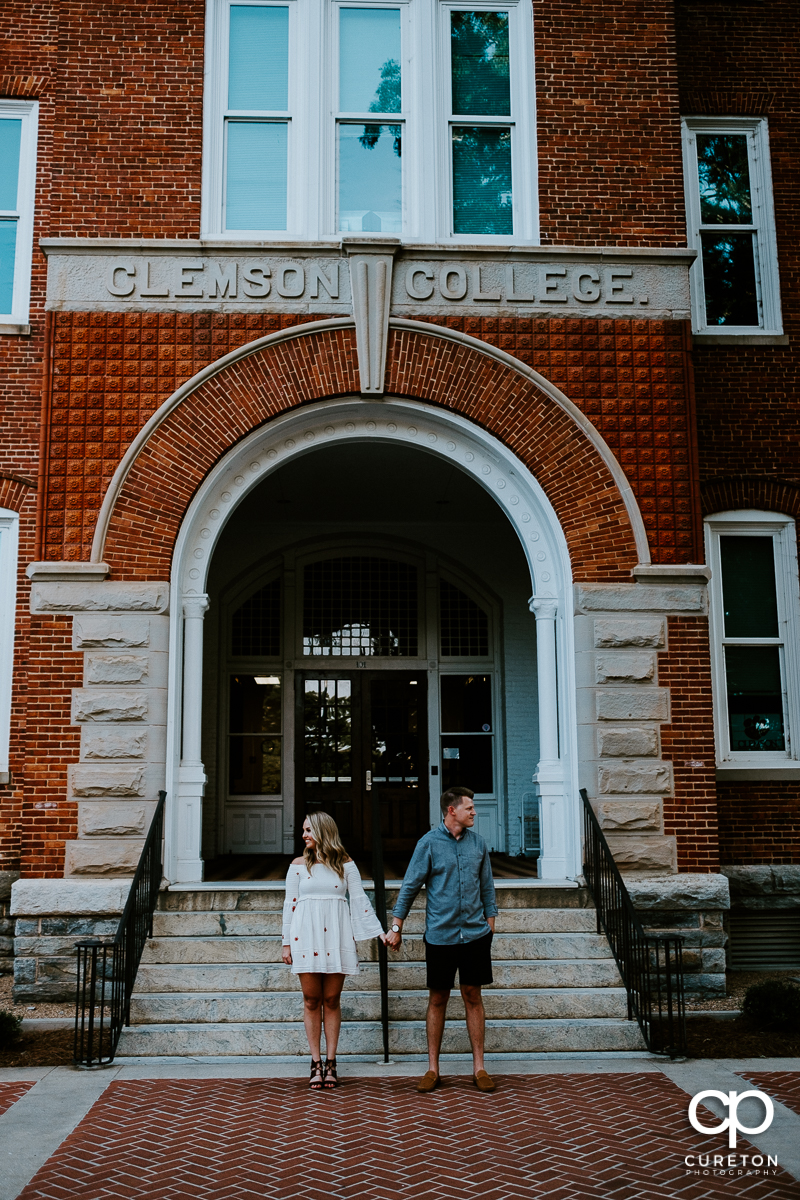 Couple in front of Tillman Hall during an engagement session on the Clemson University campus.