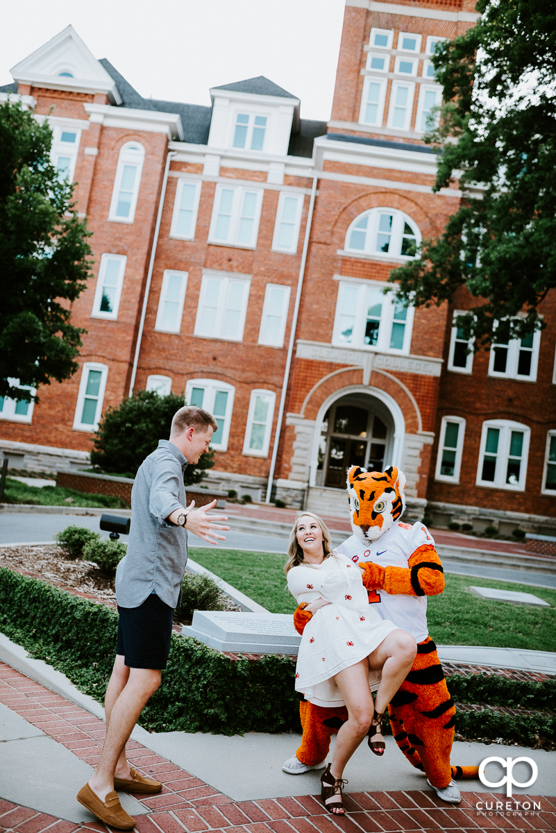 Clemson Tiger mascot dipping a future bride while her fiancee looks on.
