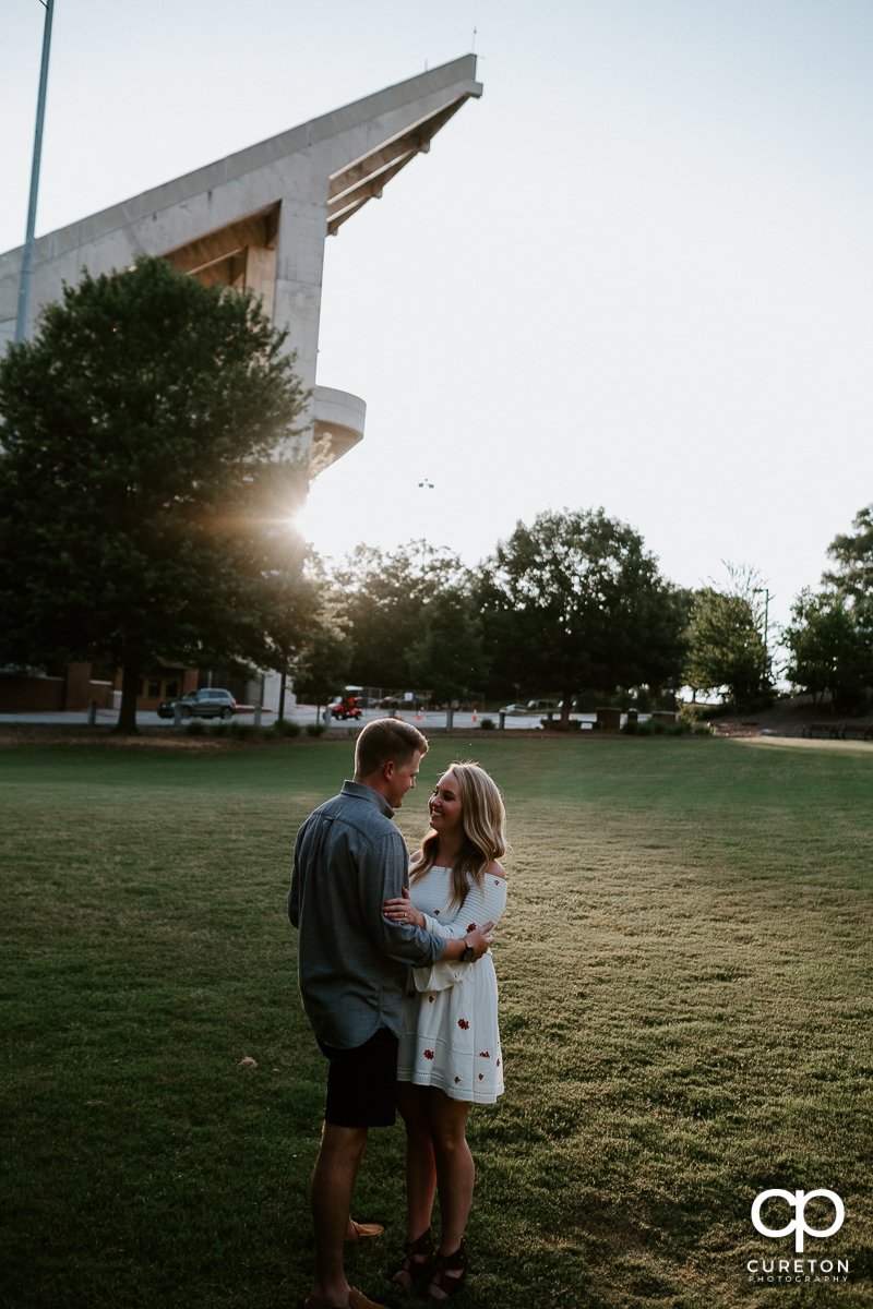 Engaged couple outside the stadium in Clemson.