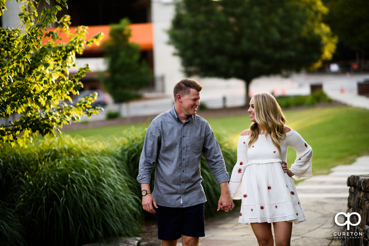 Man walking though Clemson with his fiancee.
