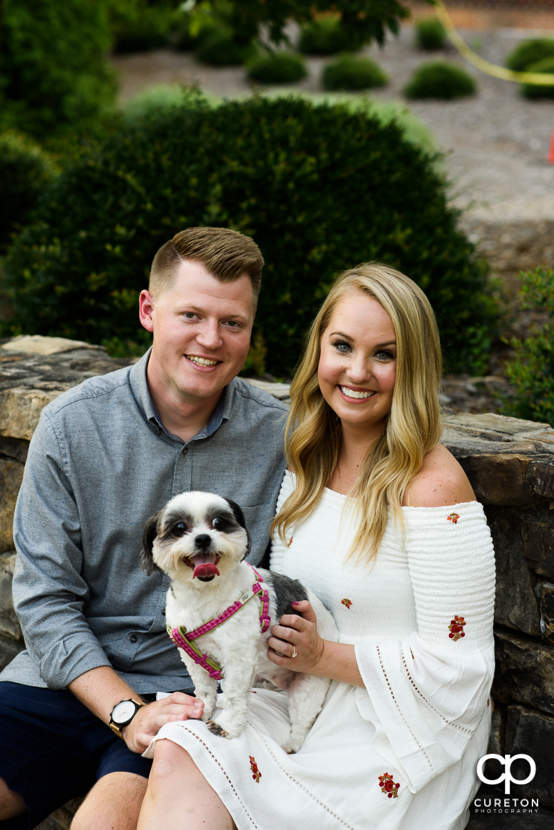 Engaged couple with their dog.