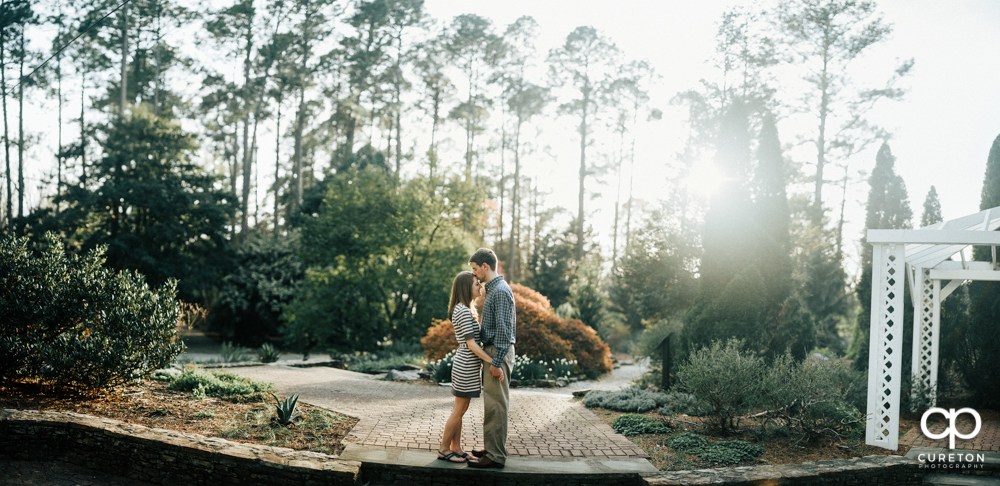 Pano of a couple during an engagement session at the Botanical Gardens in Clemson.