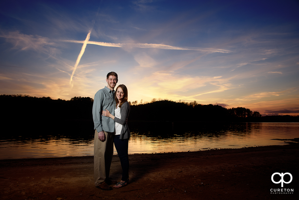Sunset engagement session by the lake in Clemson SC.