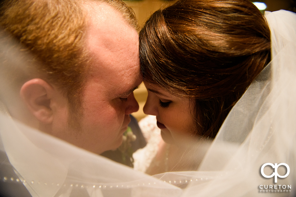 Closeup of a bride and groom after their wedding.