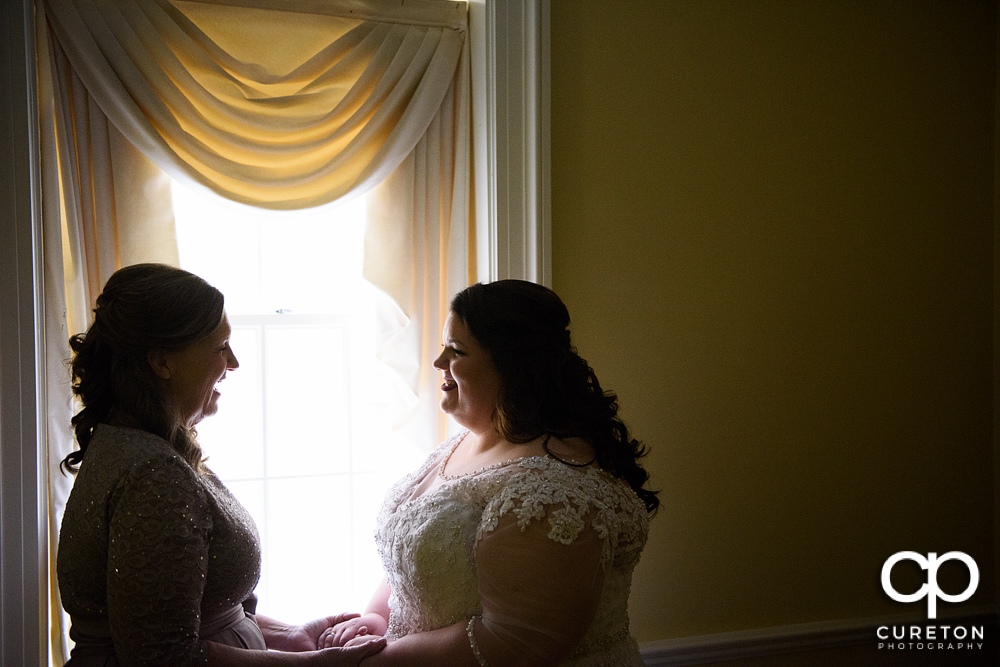 Bride and her mother having a moment before the wedding ceremony.