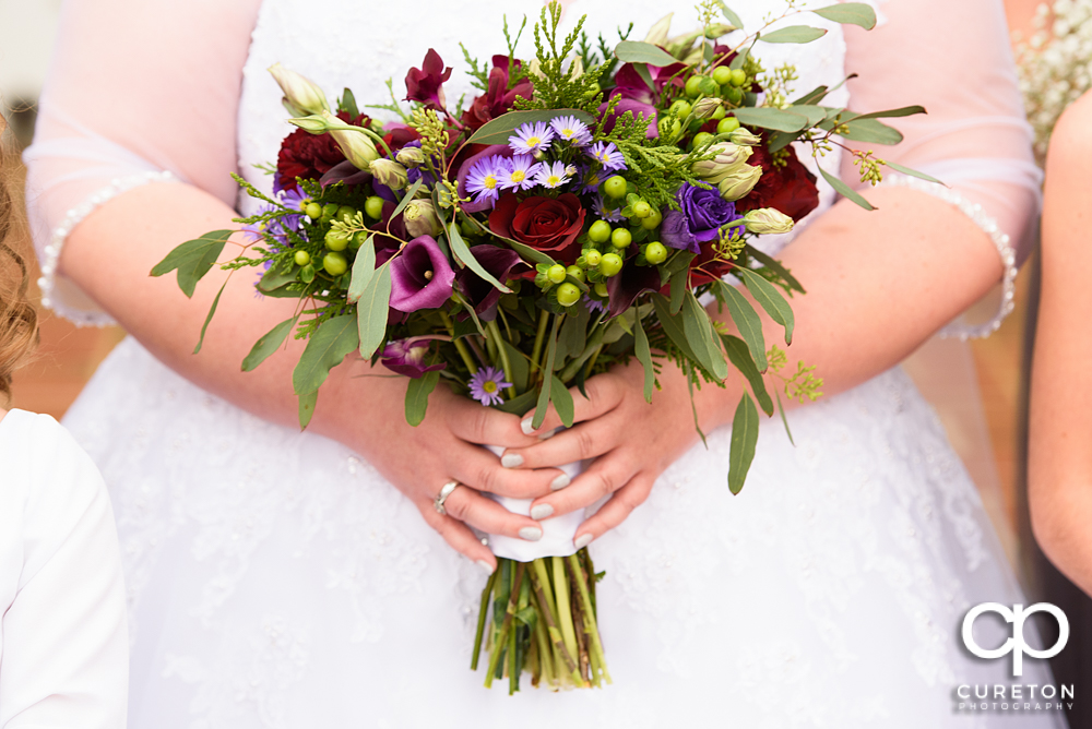Brides amazing bouquet by Greg Foster.