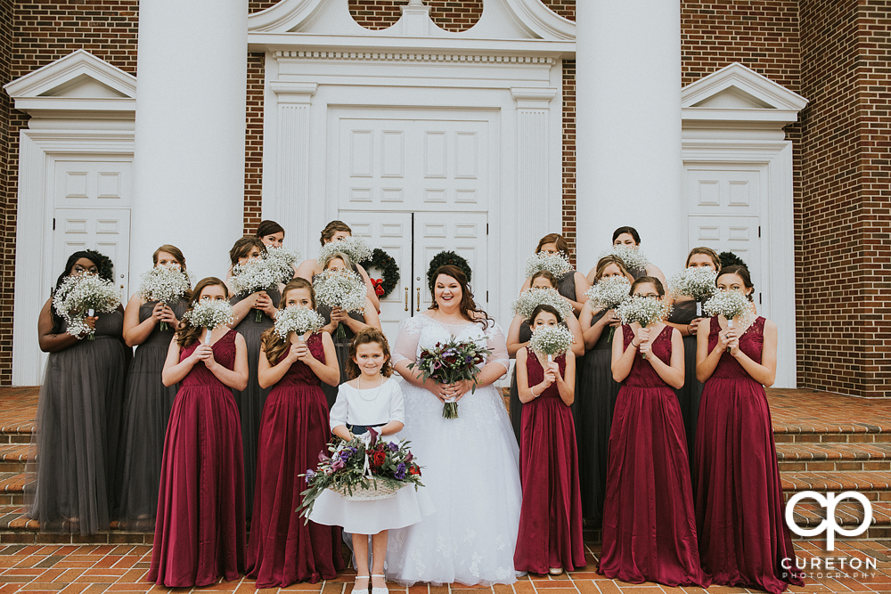Bride and bridesmaids on the steps of the church before the Spartanburg wedding.