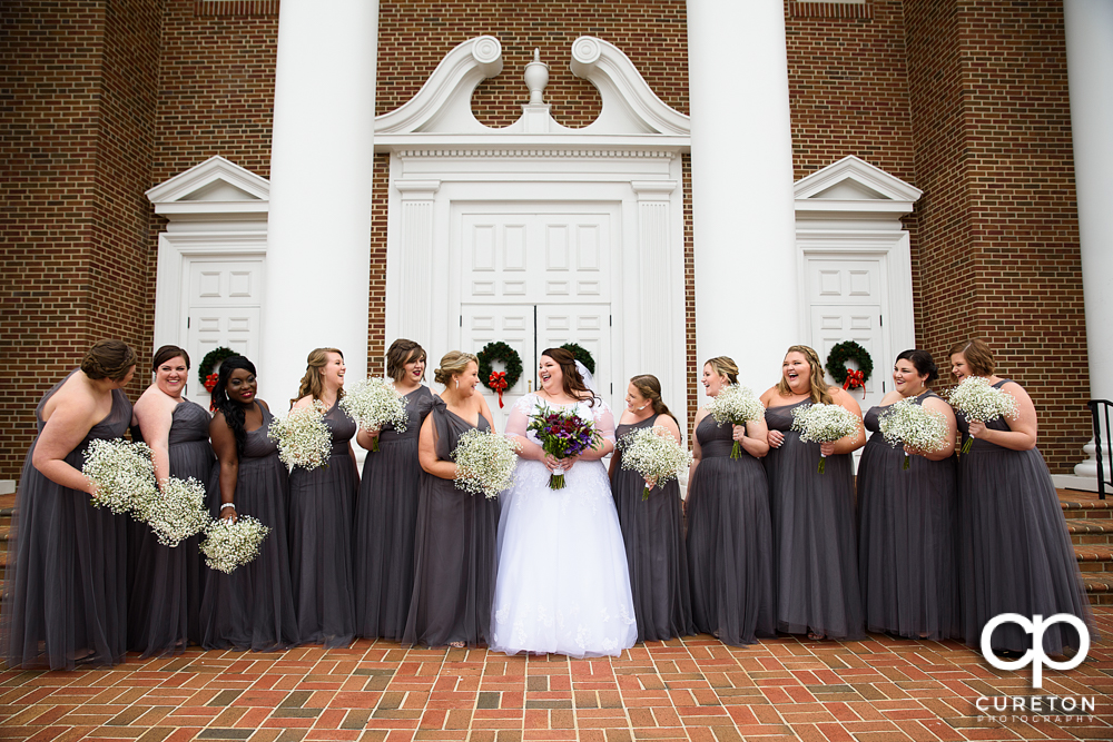 Bride and bridesmaids laughing before the Spartanburg wedding.