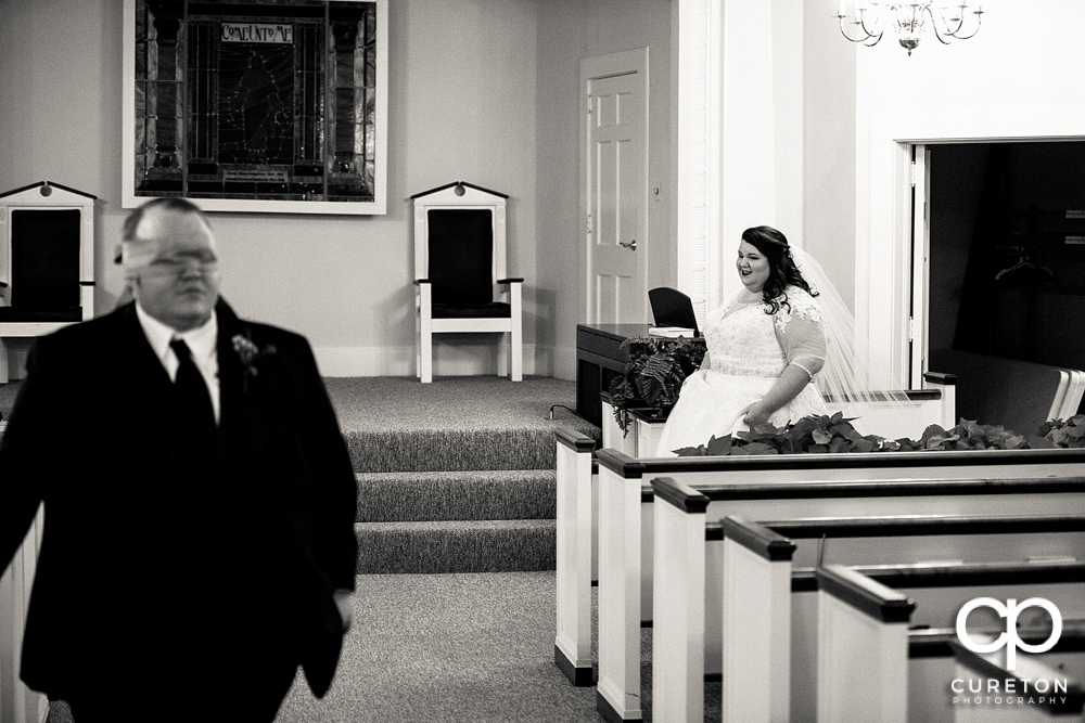 Bride walking up n her first touch with the groom.
