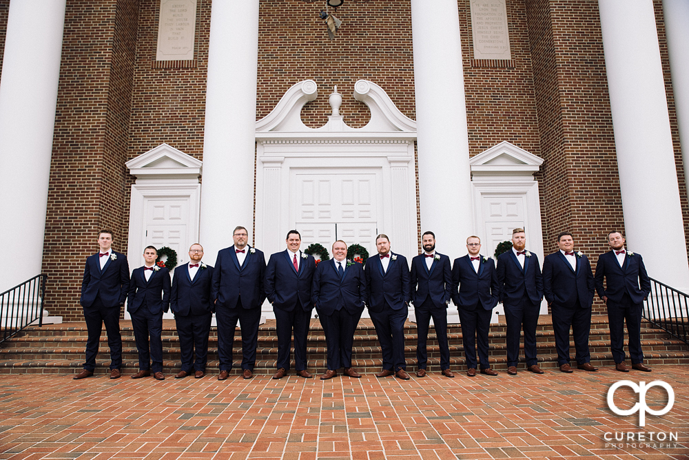 Groomsmen lining up outside the church.