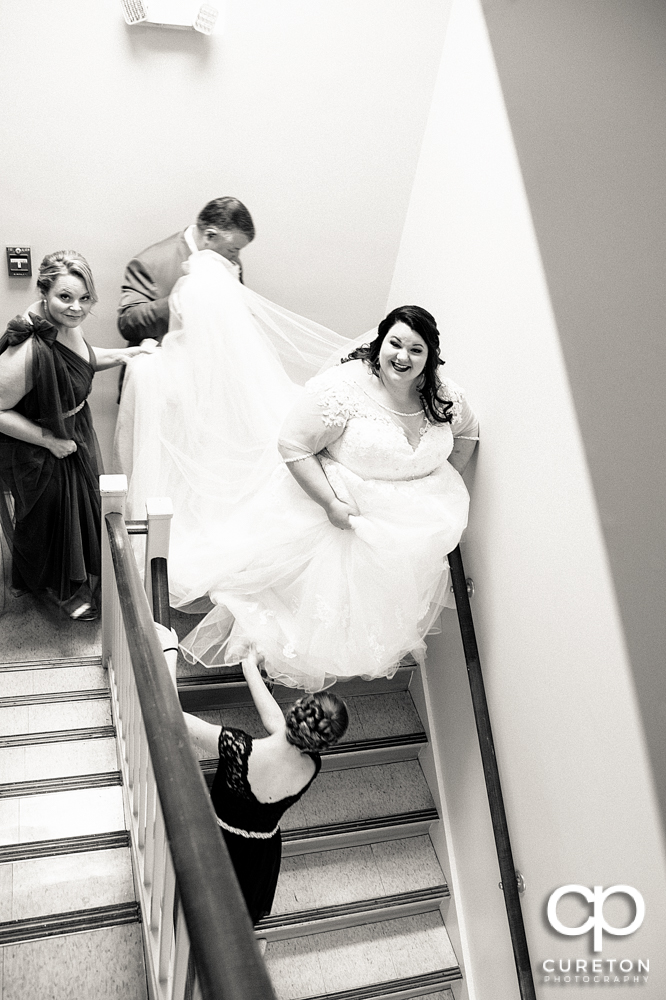 Bride walking down the steps to the ceremony.