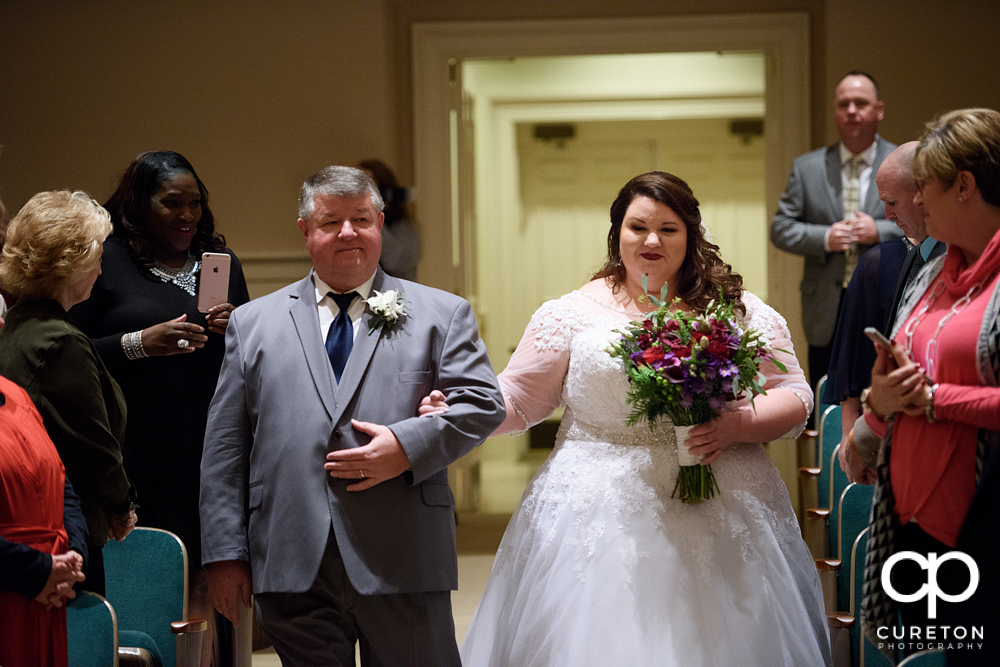 Bride and her father walking down the aisle at Southside Baptist Church in Spartanburg.
