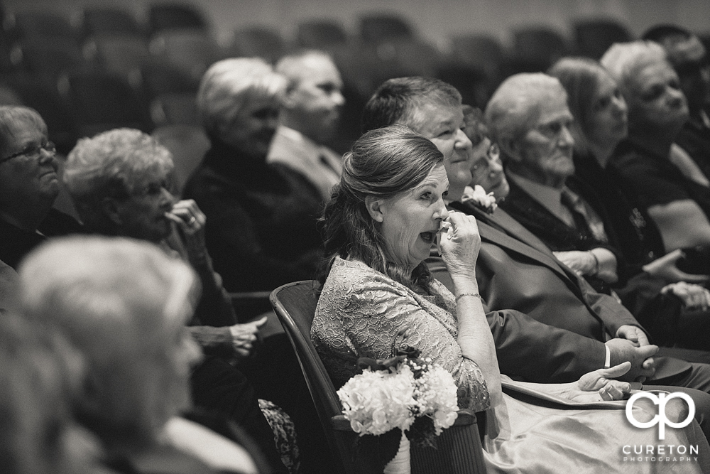 Bride's mother crying during the ceremony.