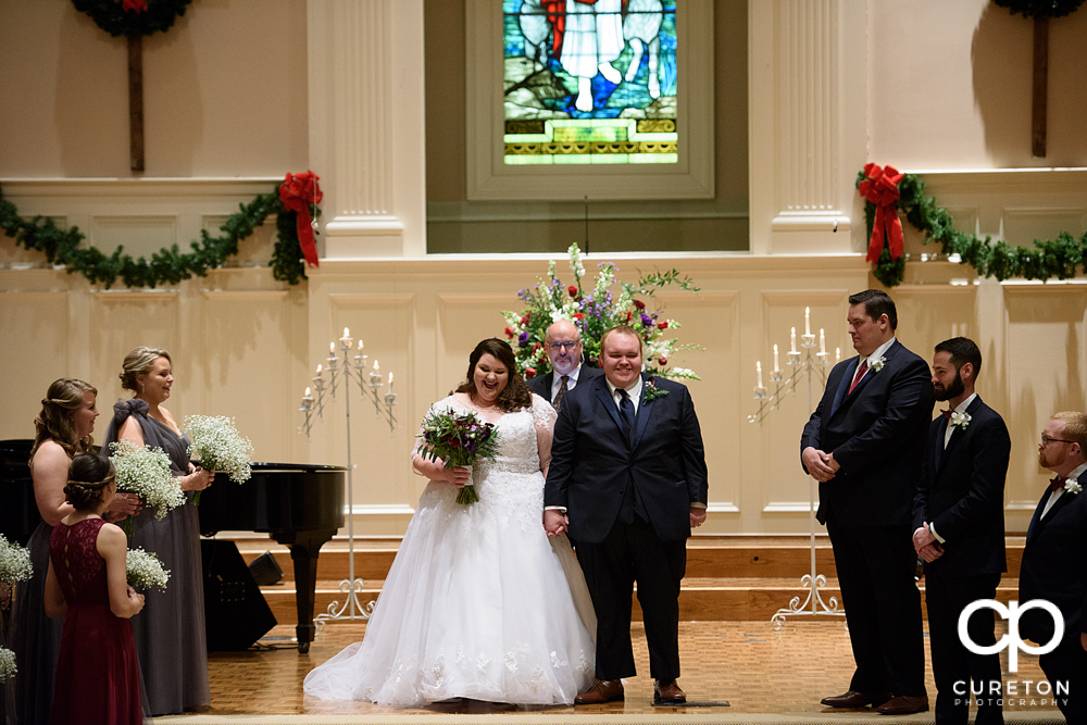 Bride and groom being presented to the church.