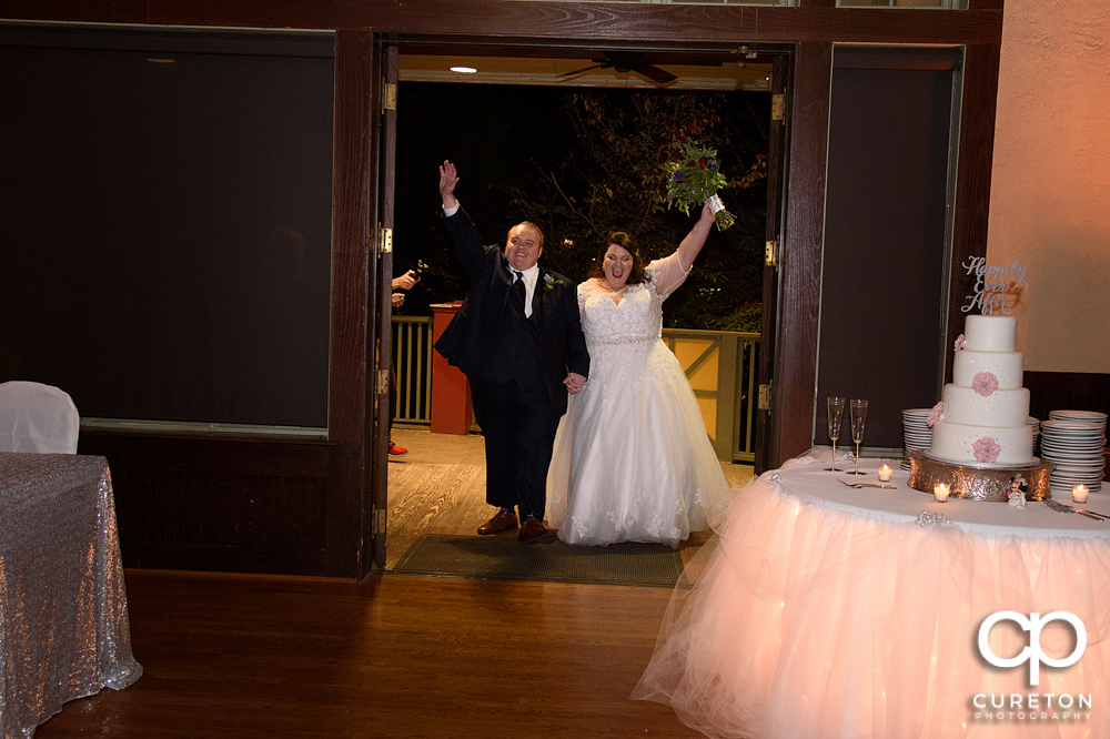 The bride and groom entering the reception.