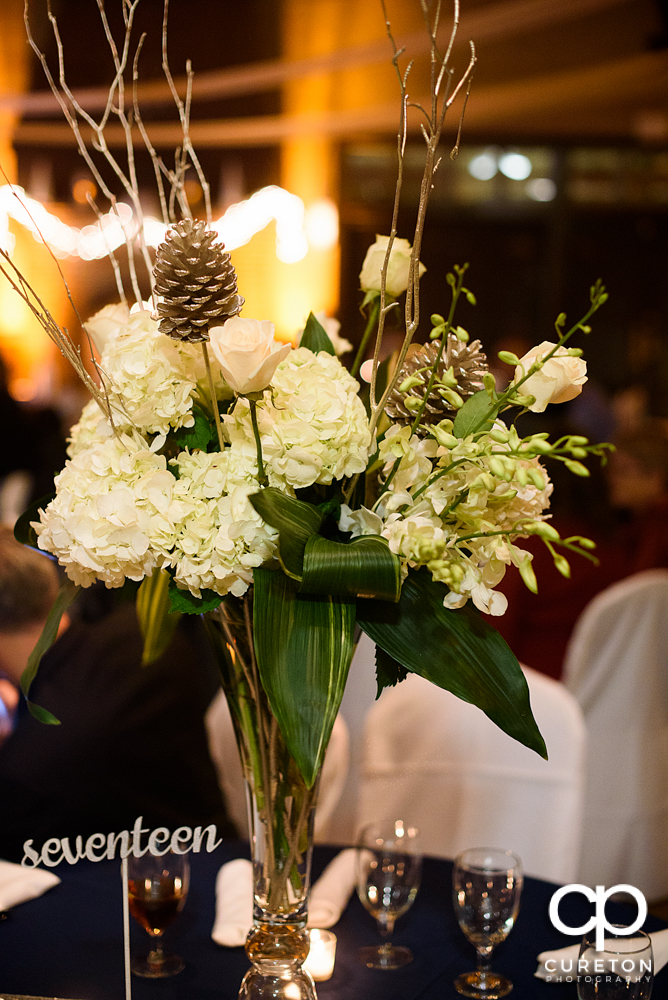 Centerpieces by Greg Foster.