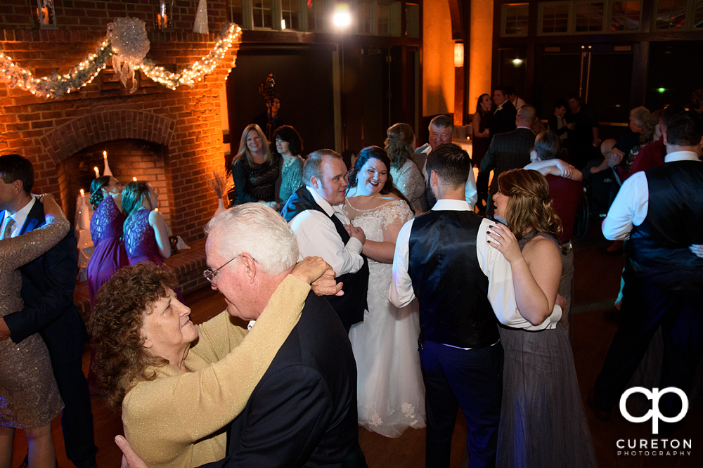 Wedding guests dancing to the sounds of Greenville wedding dj Uptown Entertainment.