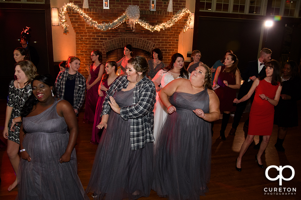 Wedding guests dancing to Uptown Entertainment.