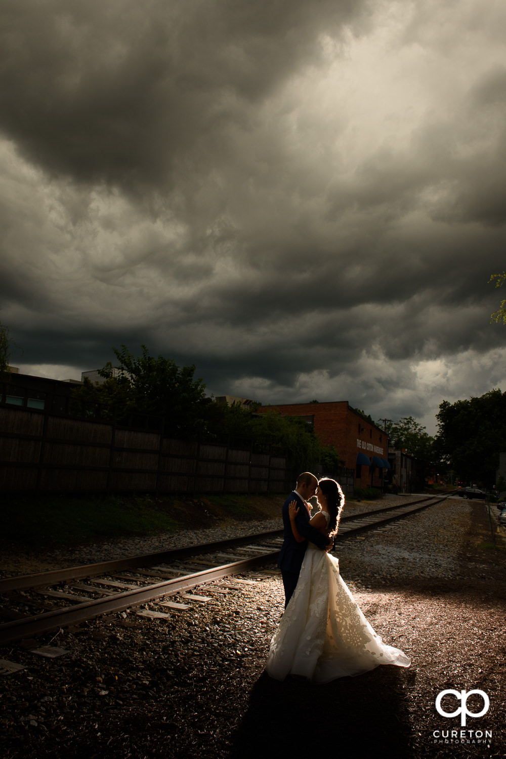 Bride and groom at sunset outside their wedding reception at The Old Cigar Warehouse in downtown Greenville.
