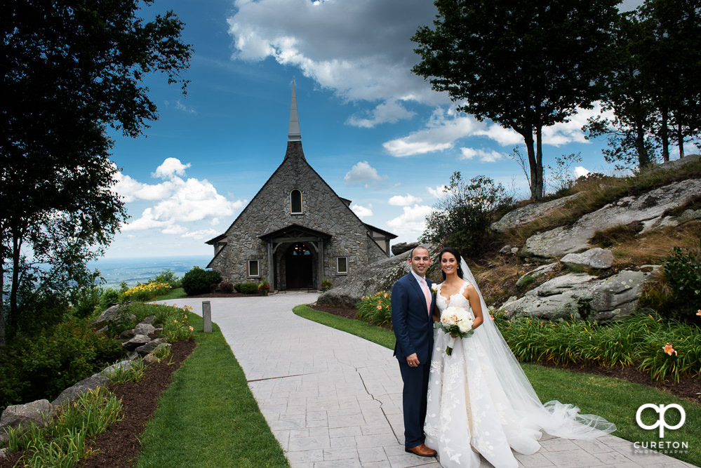 Bride and Groom in front of Glassy Chapel.