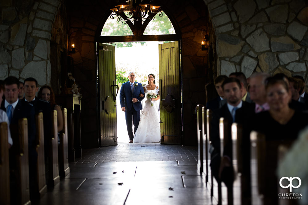 Bride and father as the doors open at Glassy chapel before she walks down the aisle at her wedding.