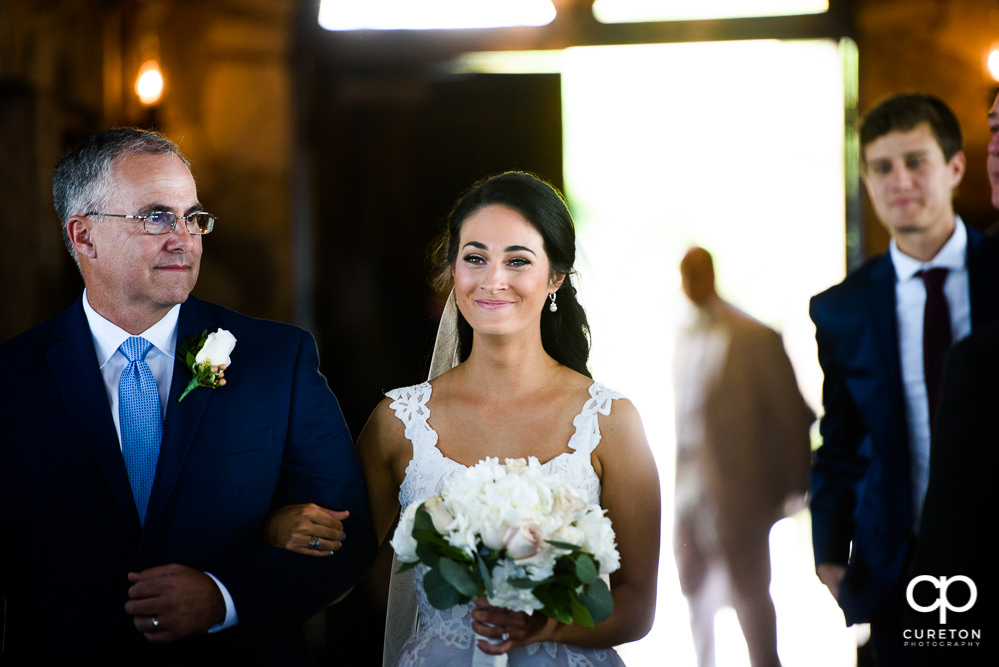 Bride and her father walking down the aisle at Glassy Chapel.