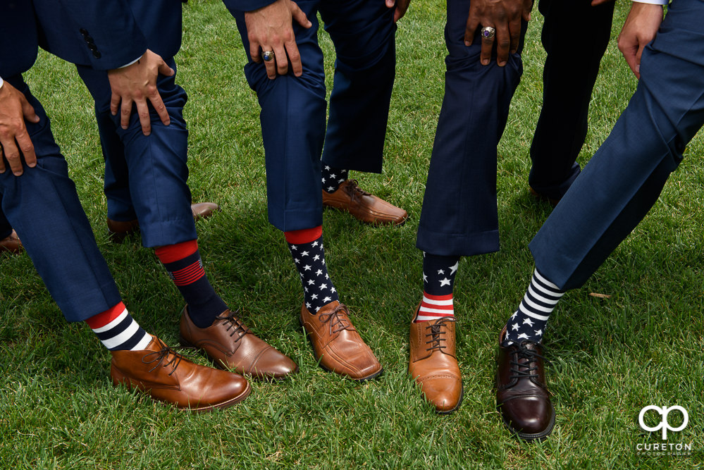 Groomsmen wearing patriotic socks.