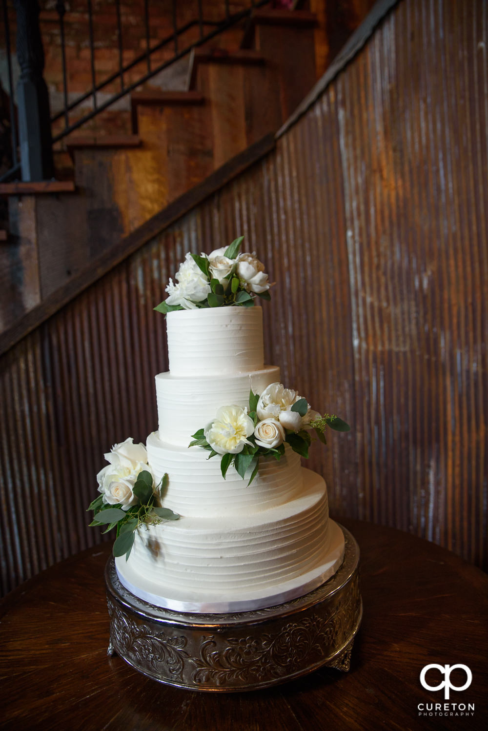 Wedding cake by Couture Cakes in Greenville.