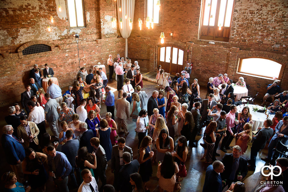 Wedding guests packed the main hall at The Old Cigar Warehouse for the reception.