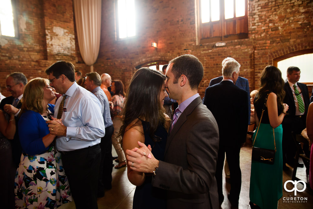 Wedding guests dance at the Old Cigar Warehouse reception.