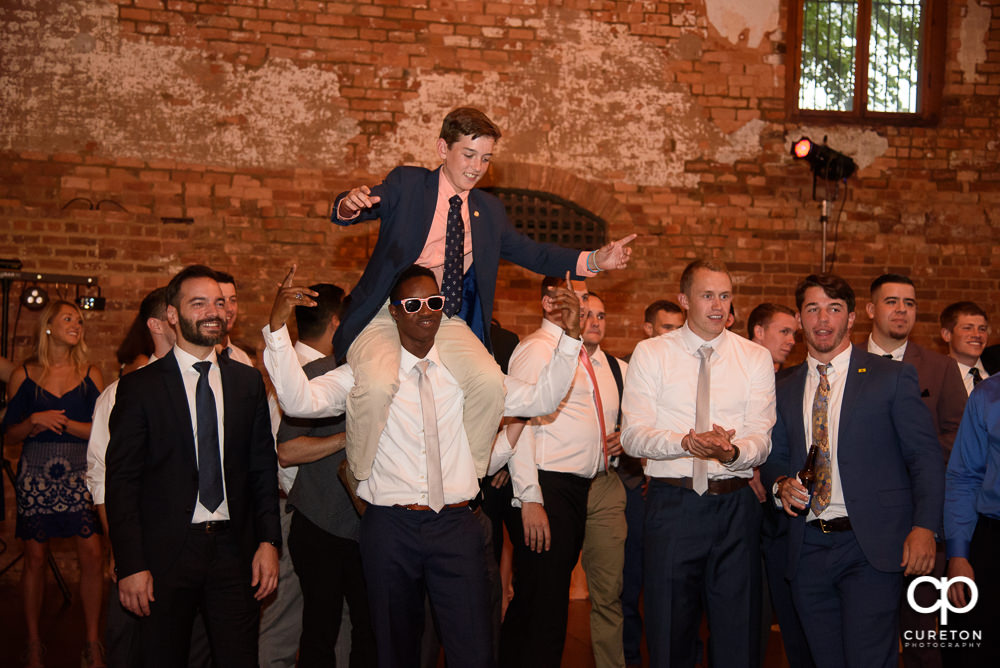 Groom gets iced during the garter removal.