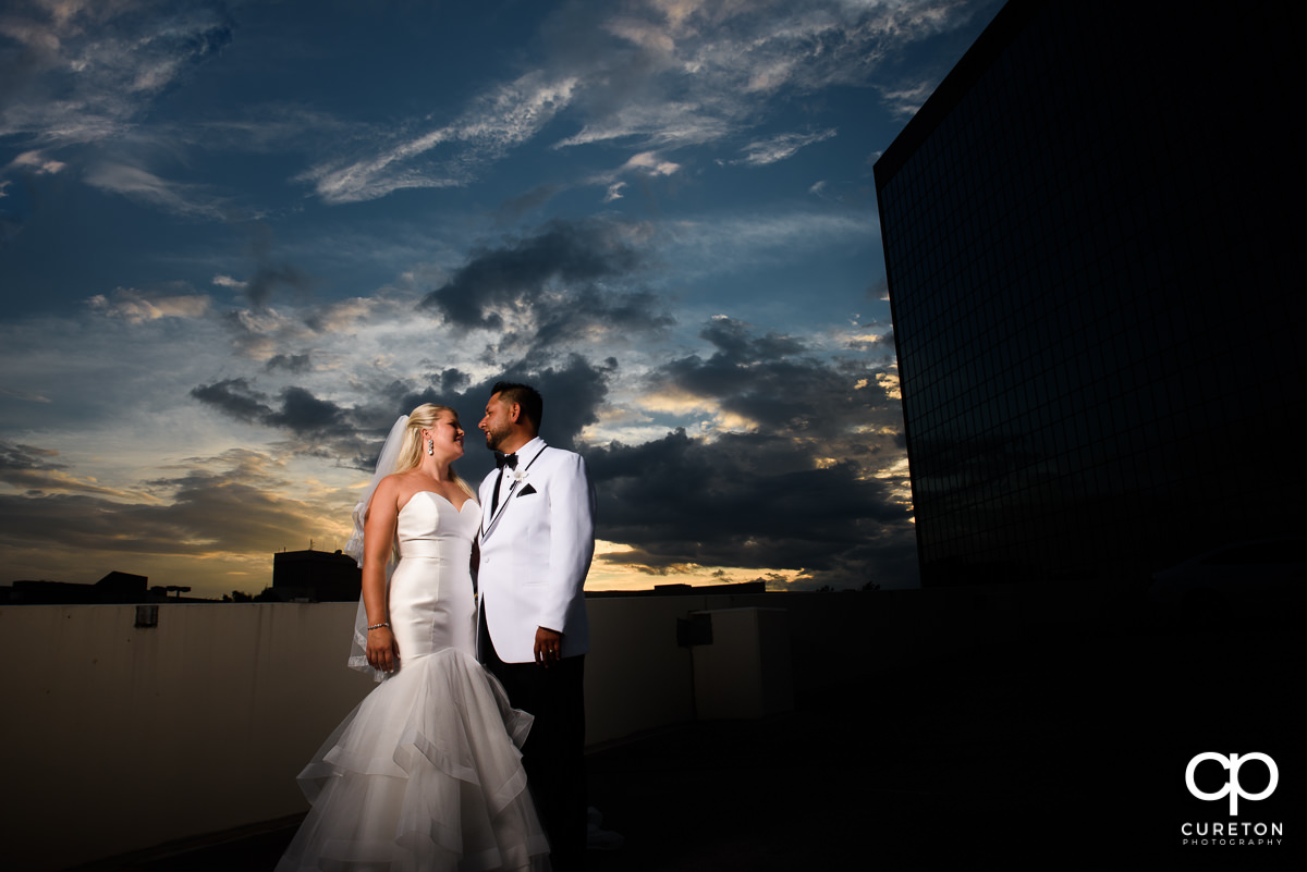 Bride and groom at sunset at their Commerce Club wedding.