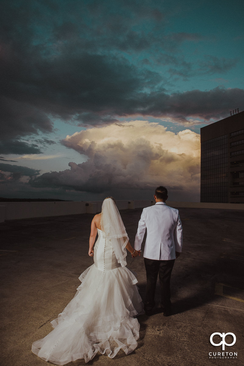 Newlywed couple on the rooftop at their Commerce Club wedding.