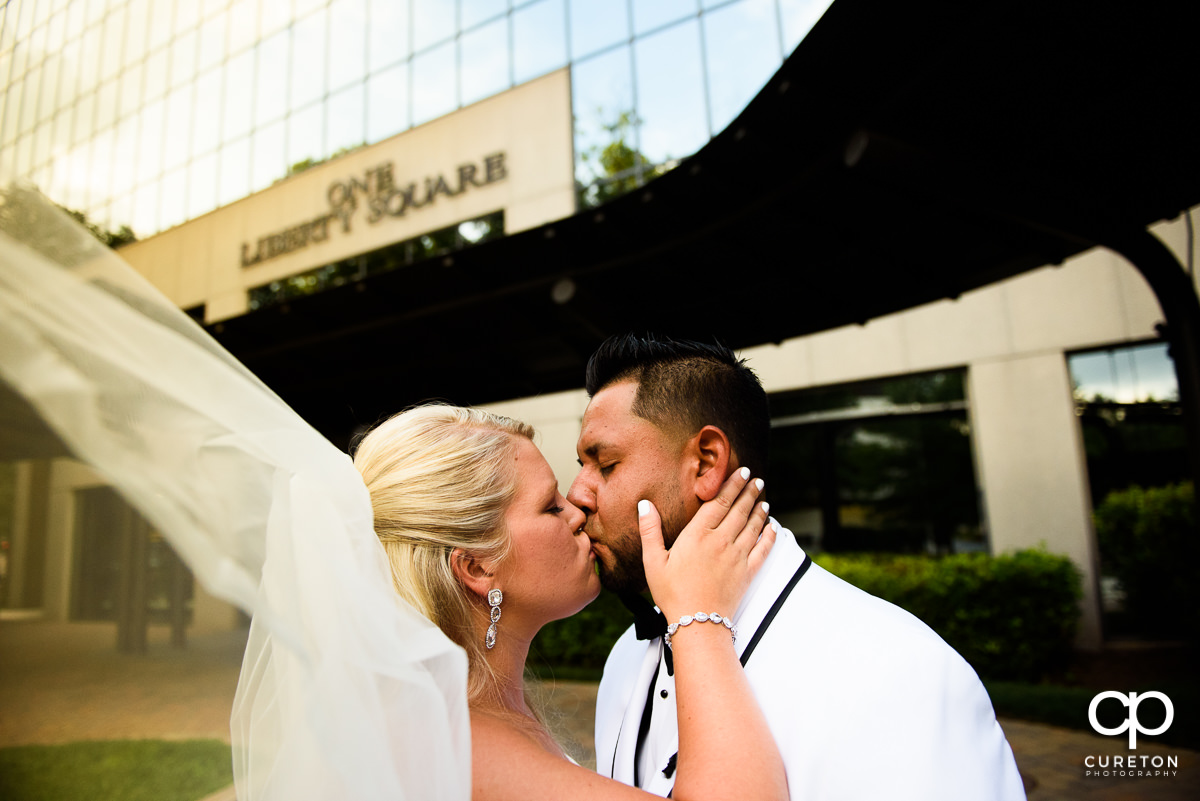Bride kissing her groom.