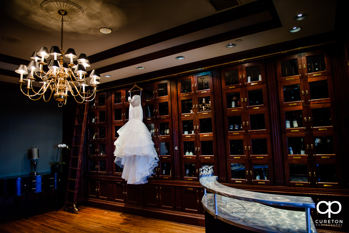 Bride's dress in the wine room.