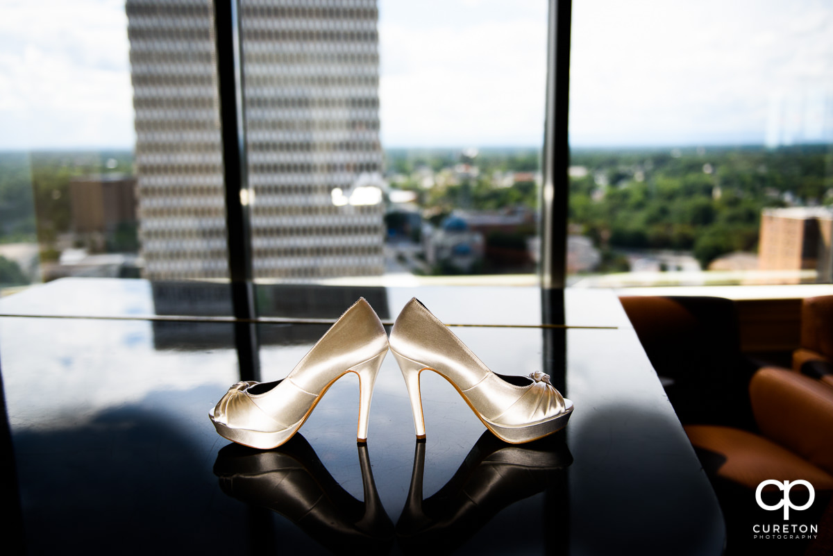 Bride's shoes on a piano.