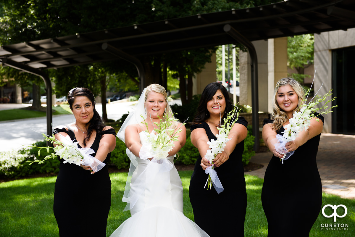 Bride and her bridesmaids outside the Commerce Club.