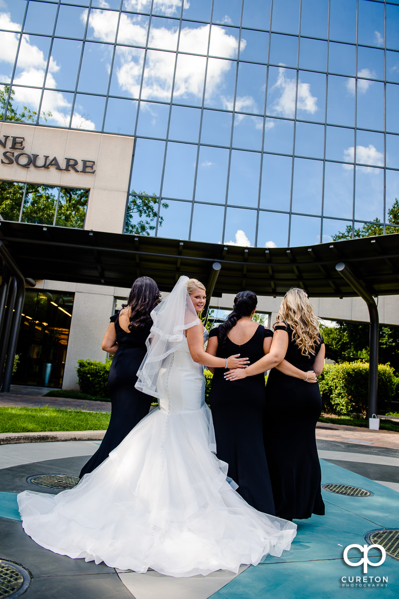 Bride and her bridesmaids from behind.