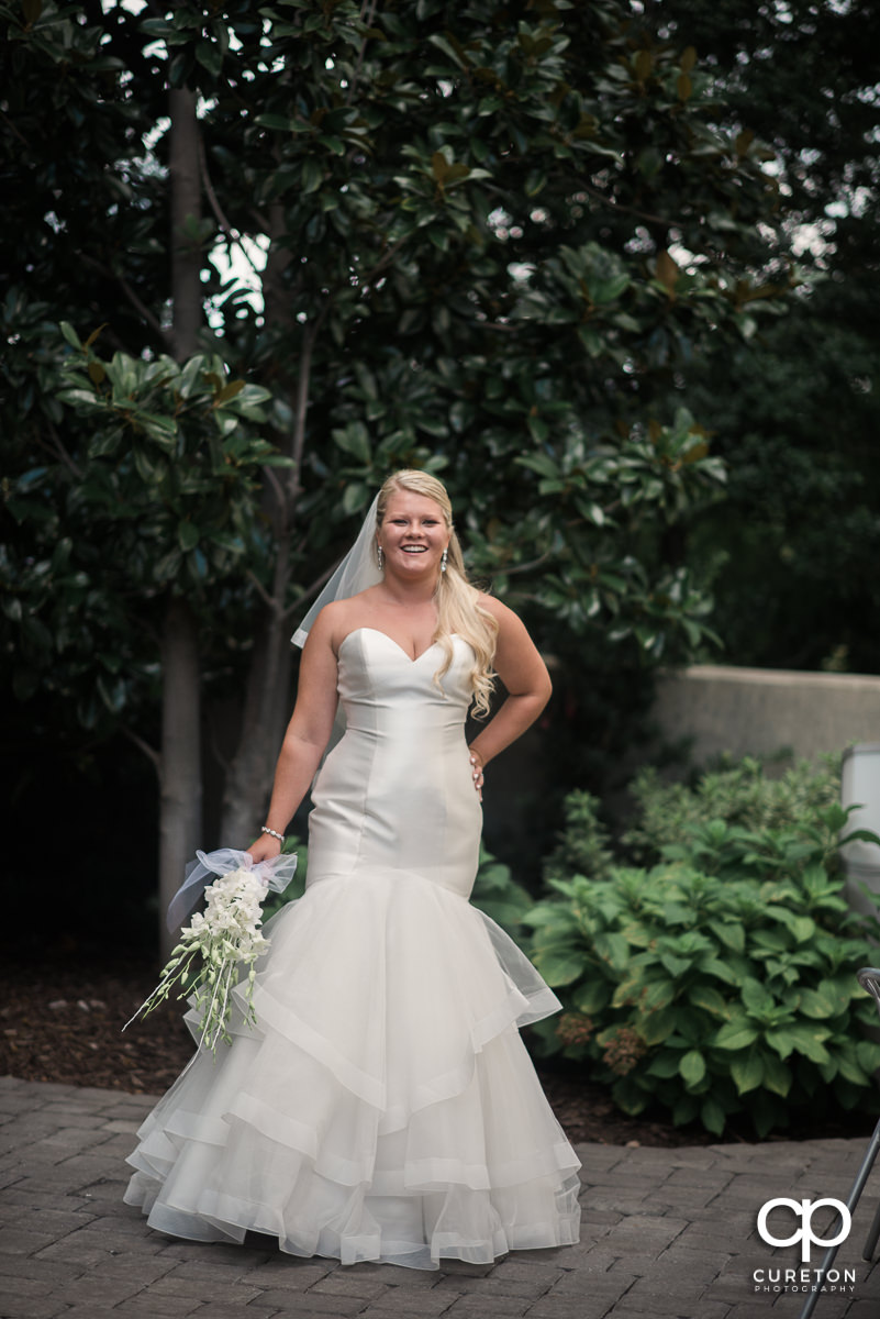 Bride smiling outside the Commerce Club.