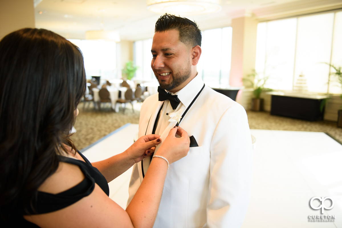 Groom getting his boutonieer.
