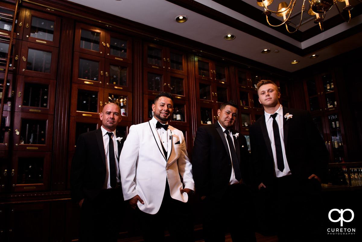 Groom and groomsmen in the wine room at the Commerce Club before the wedding.