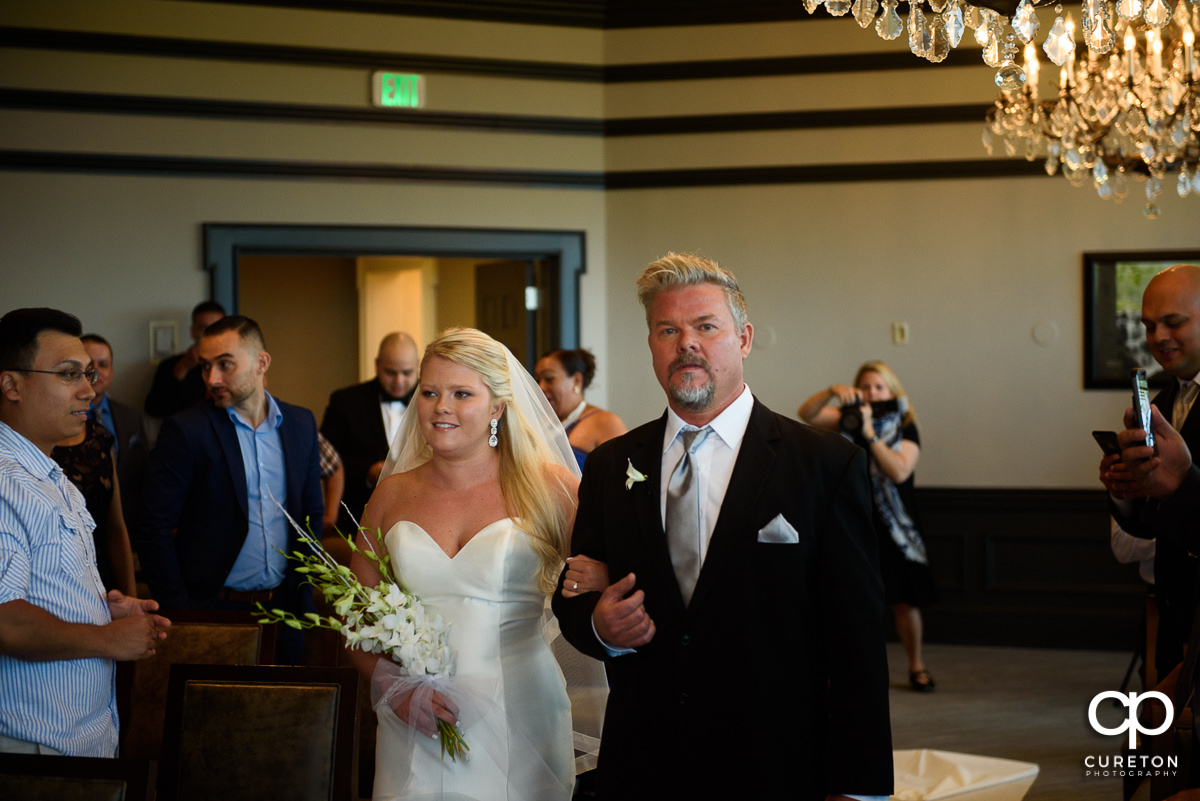 Bride and her father walking down the aisle at the Commerce Club.