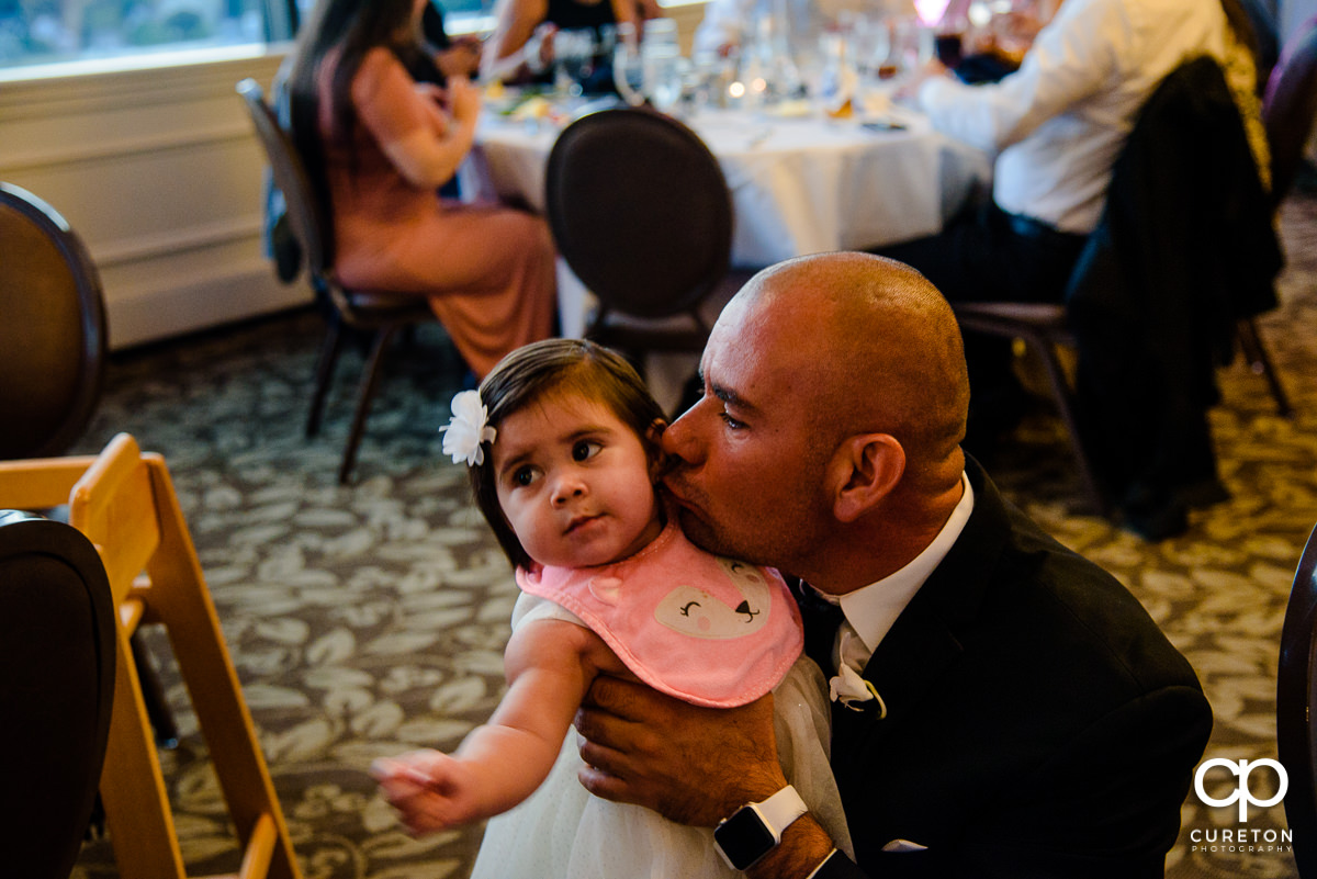 Groomsmen and his daughter at the reception.