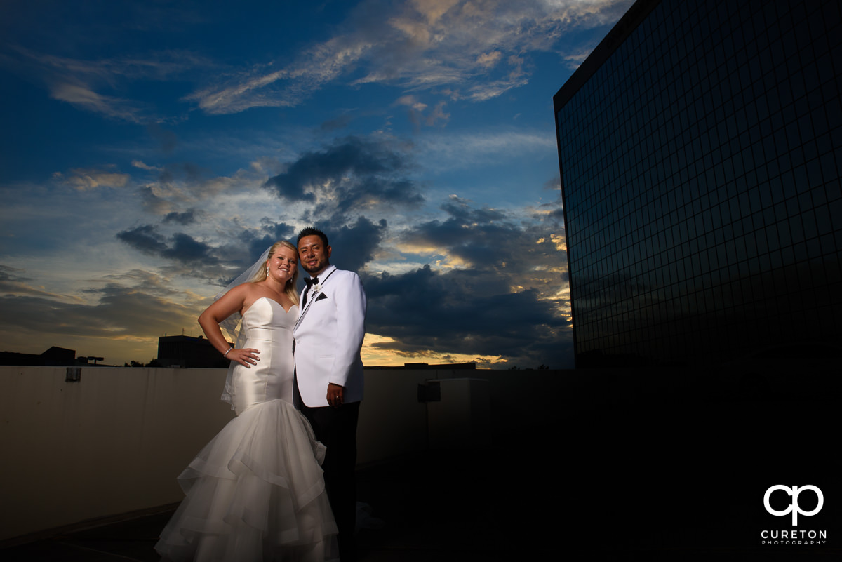 Bride and groom with epic sunset background.