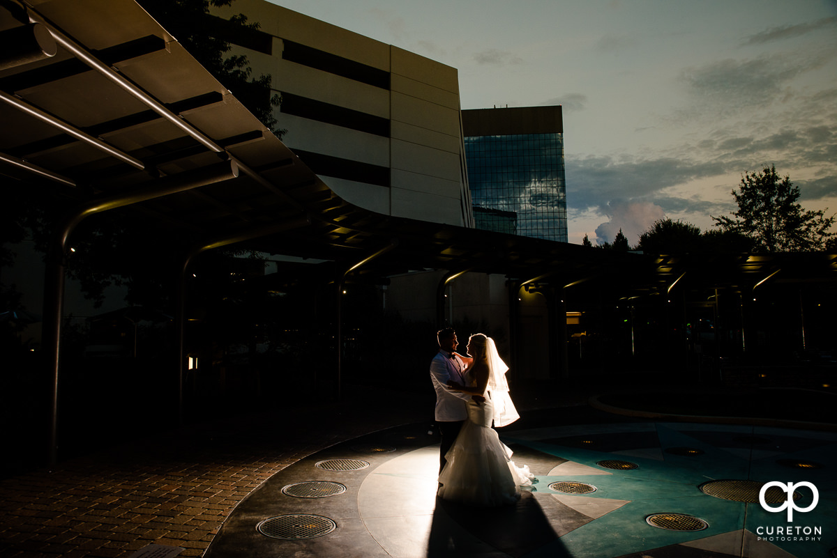 Epic backlit photo of bride and groom at the Commerce Club.