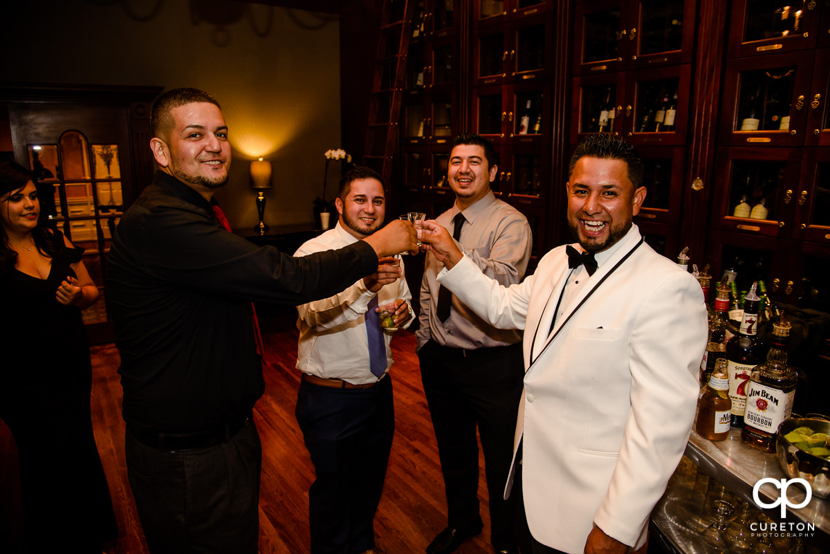 Groom and friends at the bar.