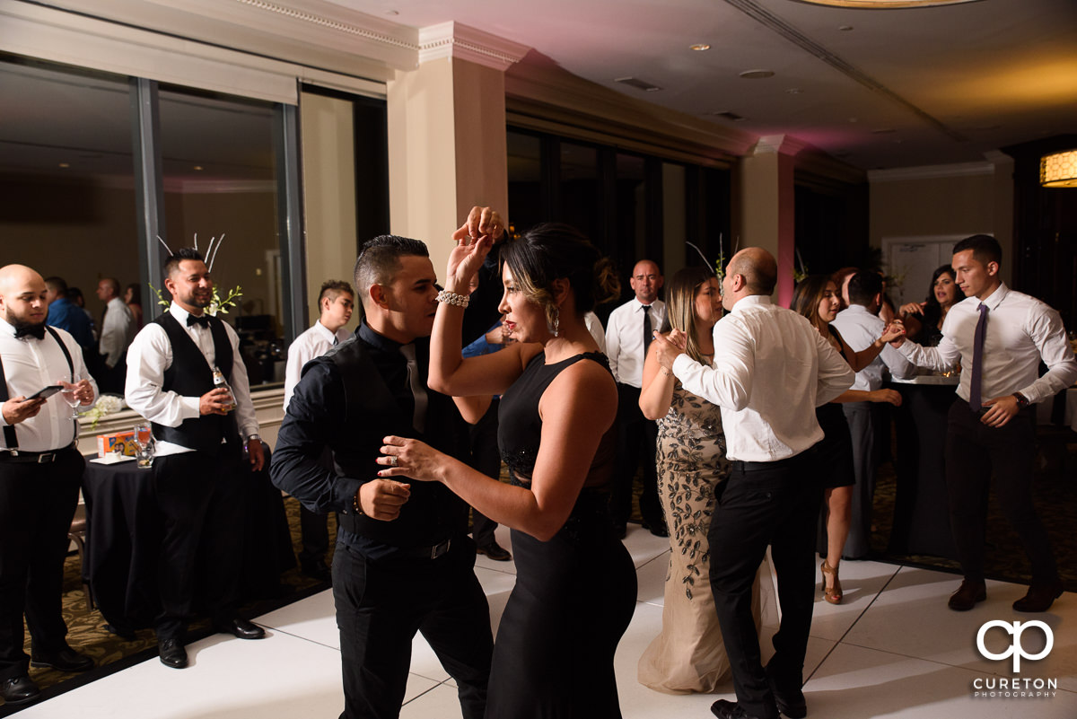 Wedding reception guests dancing at the Commerce Club.